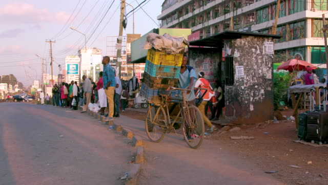Man Carries Goods On Bicycle Near Bus Stop Ngong Road, Nairobi, Kenya, Africa