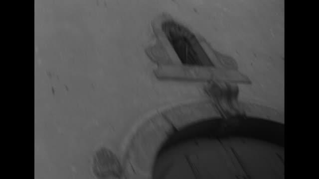 vídeos y material grabado en eventos de stock de man carries heavy bundle of hay and loads sledge / tilted view of church window with pan down to door / silhouetted church bell with snowy mountain... - haz de luz