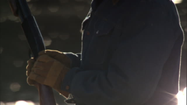 stockvideo's en b-roll-footage met man carries shotgun, yellowstone, usa - jachtgeweer