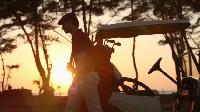 man carrying a golf bag  - golf cart stock videos and b-roll footage