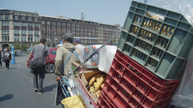 man carrying bananas in boxes using a cart. at zocalo mexico city cdmx - newly industrialized country stock videos & royalty-free footage