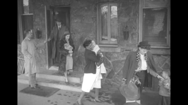 stockvideo's en b-roll-footage met man carrying clothing africanamerican woman carrying a white baby and temporary governor herman talmadge exit the georgia governor's mansion upon the... - georgia us state