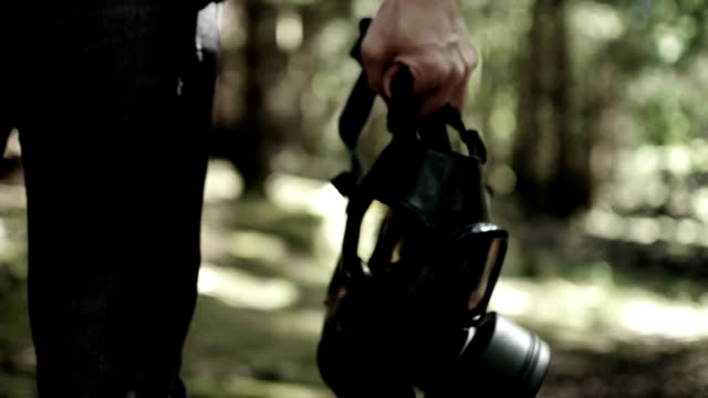 man carrying gas mask - desaturated stock videos & royalty-free footage