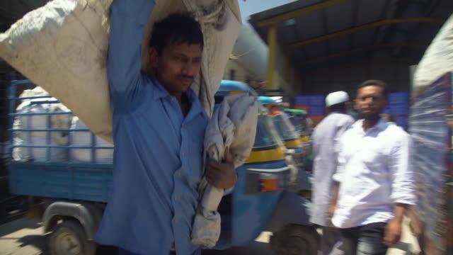 Man carrying silkworm cocoon sack at market at Ramanagara, Bangalore, farmers and buyers, South India