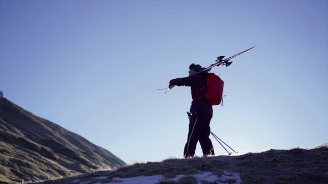 man carrying skis along a hill in the mountains - ski holiday stock videos & royalty-free footage