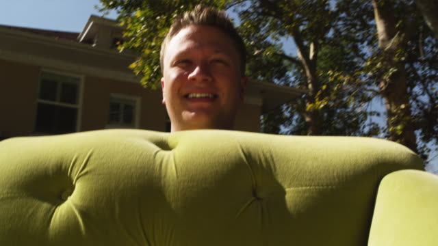 vidéos et rushes de cu pov man carrying sofa into house /  provo, utah, usa - provo