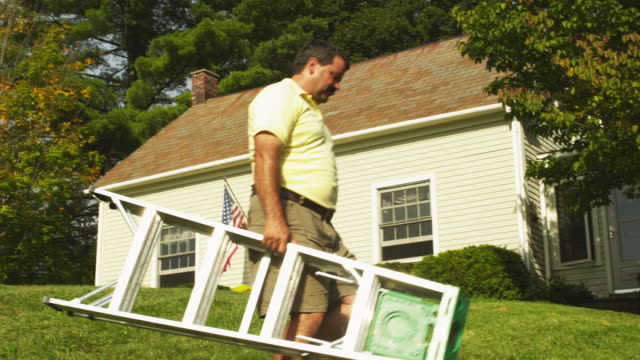 ms pan man carrying step ladder to front of home, manchester, vermont, usa - step ladder stock videos & royalty-free footage
