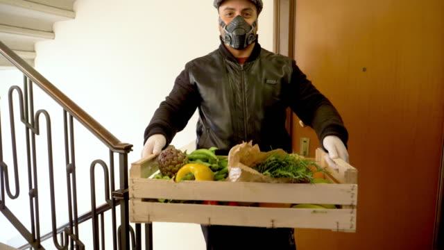 man carrying vegetables - schiebermütze stock-videos und b-roll-filmmaterial
