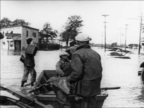 man carrying woman from boat to car in flood / people + boats in foreground / sacramento, ca - 1926 stock videos & royalty-free footage