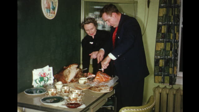 1956 HOME MOVIE Man carving ham and  turkey / Toronto, Canada