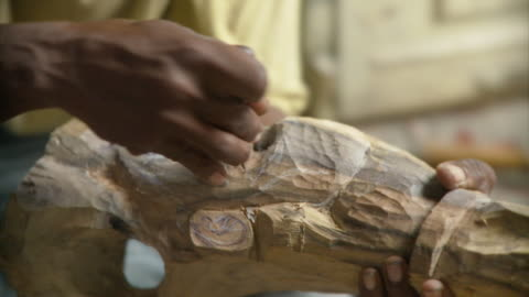 cu pan r/f man carving wood scuplture / havana, cuba - human representation stock videos & royalty-free footage