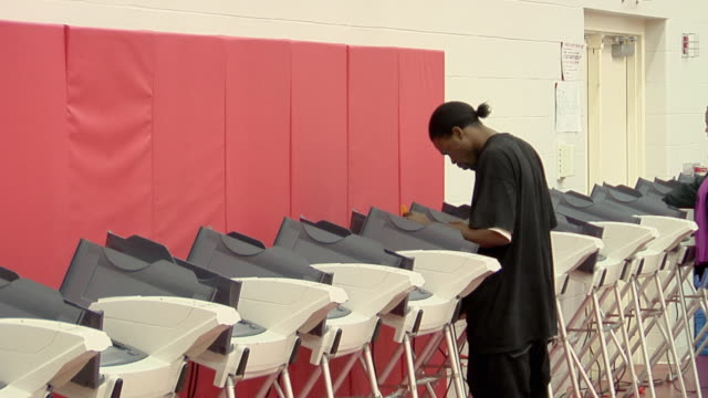MS, Man casting vote at electronic voting machine, Toledo, Ohio, USA