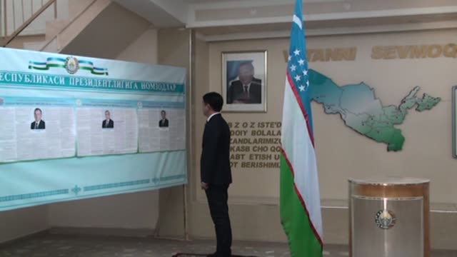 A man casts his ballot on November 24 2016 at a polling station in Tashkent Uzbekistan during the early voting period prior to presidential elections...