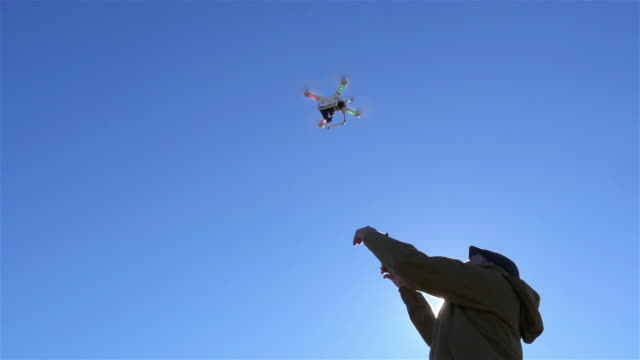 man catching a flying drone - pilot stock videos & royalty-free footage
