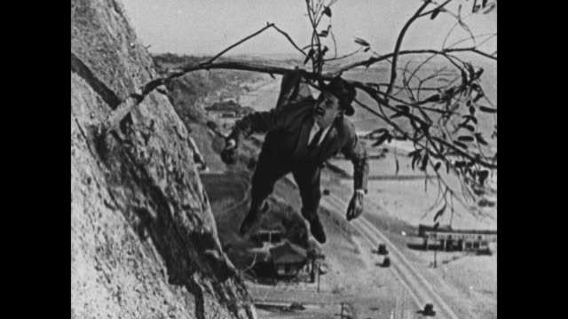 1924 man caught in tree lets go of other man after stealing his money, throws money up to women - wallet stock videos & royalty-free footage