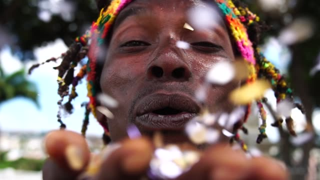 man celebrating life with confetti - jamaican ethnicity stock videos and b-roll footage