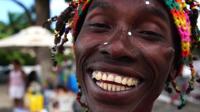 man celebrating life with confetti - jamaica stock videos & royalty-free footage