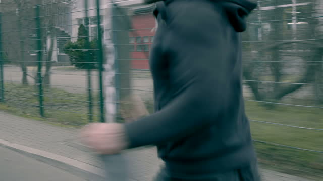 vídeos de stock e filmes b-roll de man chased and caught from red car - outdoor pursuit