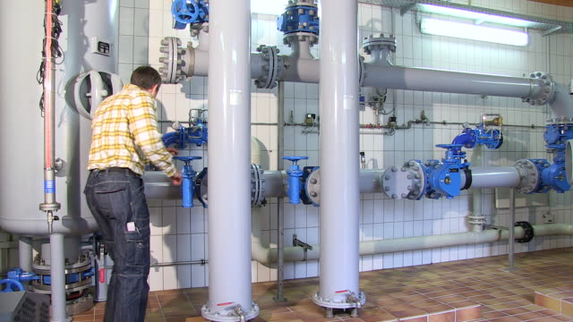 ms pan man checking controls in pump station at water reservoir / konz, rhineland-palatinate, germany - water conservation stock videos & royalty-free footage