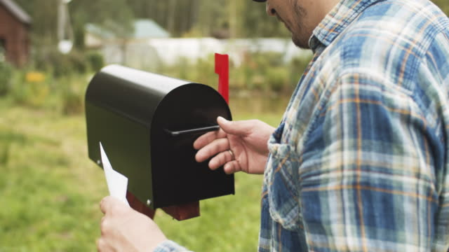 man checking mailbox near his house - letterbox stock videos & royalty-free footage