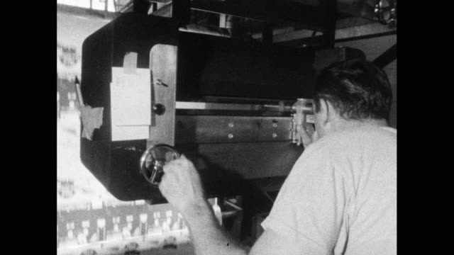 man checks quality of printing on large press; 1964 - printing out stock videos & royalty-free footage