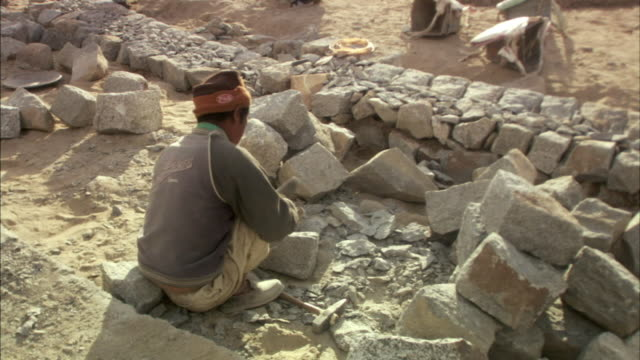 ms, ha, man chipping rocks with hammer and chisel, ladakh, jammu and kashmir, india - chisel stock videos and b-roll footage