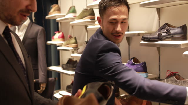 man choosing perfect shoes - sales occupation stock videos & royalty-free footage