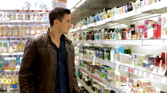 Man choosing perfume