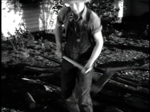 1923 ms man chopping wood with ax / united states - 1923 stock videos & royalty-free footage