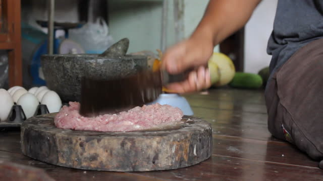 man chops pork - meat chop stock videos and b-roll footage