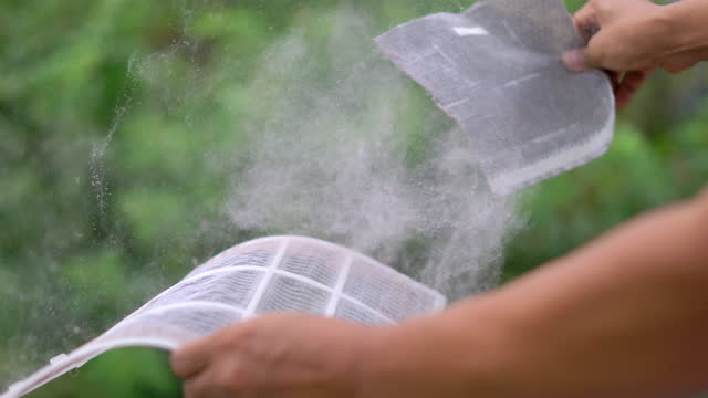 man clean dust on air filter - order stock videos & royalty-free footage