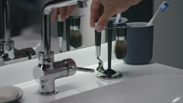 man cleaning brush - razor stock videos & royalty-free footage