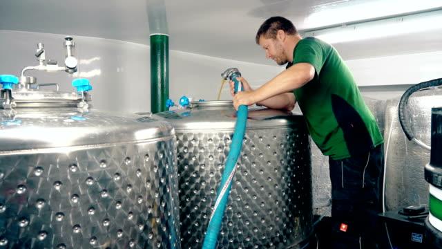 Man cleaning fermentation tank