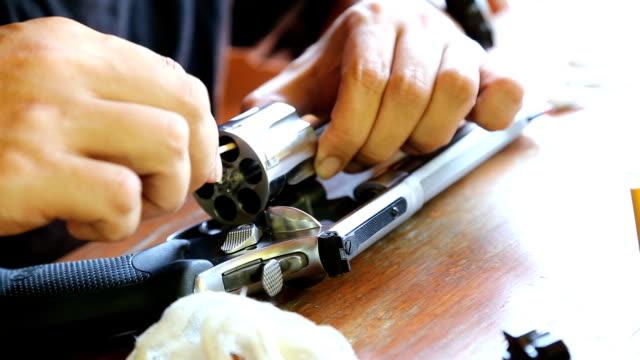 man cleaning guns - gun stock videos and b-roll footage