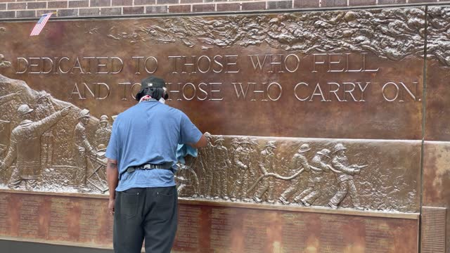 man cleans the september 11th memorial at ground zero in lower manhattan where the twin towers once stood on august 17, 2021 in new york city. nearly... - memorial stock videos & royalty-free footage