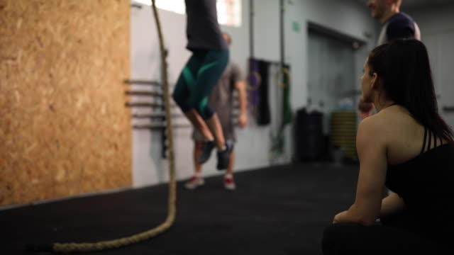 man climbing a rope - clambering stock videos & royalty-free footage