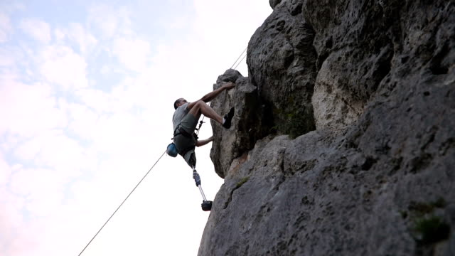 man climbing high - amputee stock videos & royalty-free footage