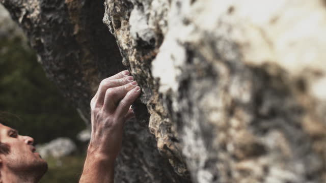 man climbing mountain during weekend - free climbing stock videos & royalty-free footage