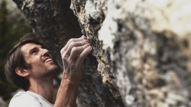 man climbing mountain during weekend - boulder stock videos & royalty-free footage