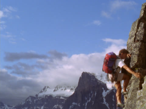 man climbing mountainside - mpeg videoformat stock-videos und b-roll-filmmaterial