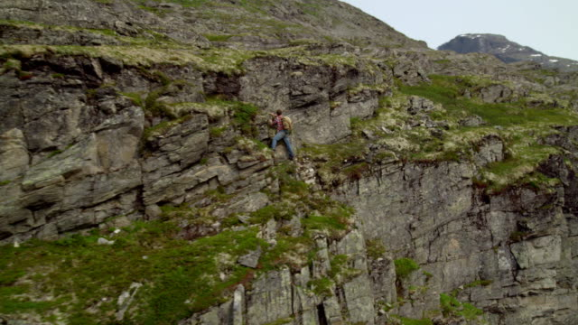 Man climbing on the vertical rock. Extreme training. Drone point of view