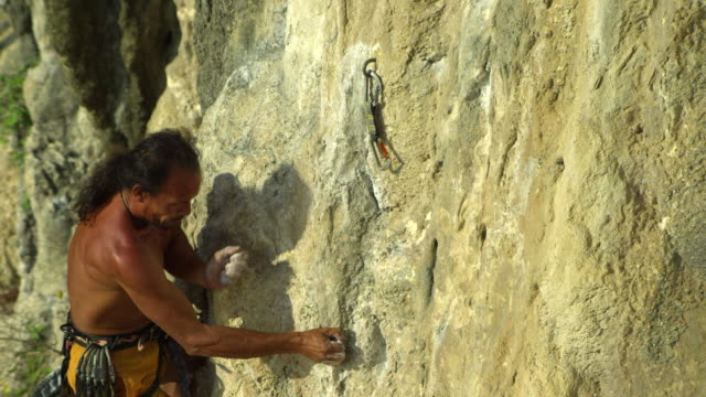 ms man climbing rock face with bare feet, clipping rope into karabiner and ascending / krabi, thailand - hex climbing equipment stock videos and b-roll footage