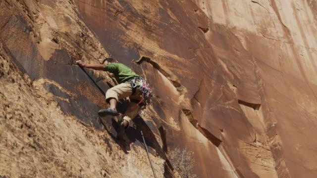 WS TD Man climbing rock / Moab, Utah, USA