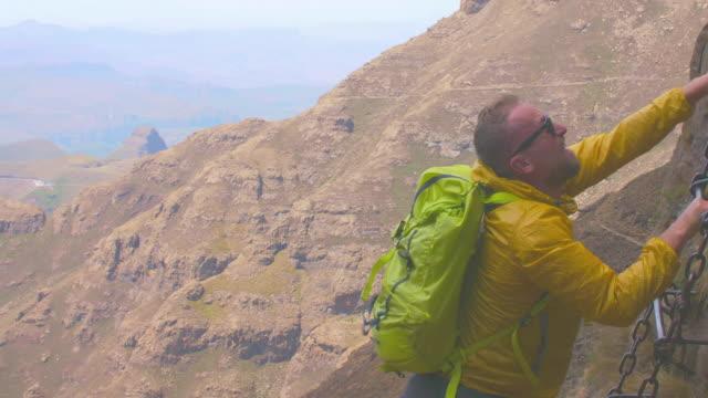 man climbs a high mountain - drakensberg mountain range stock videos & royalty-free footage