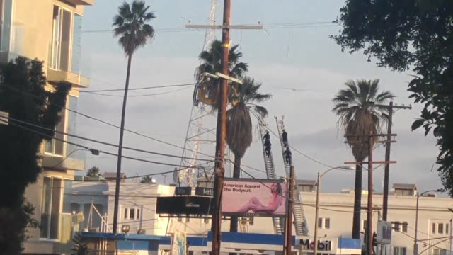 man climbs ktla radio tower prompting closure of sunset boulevard in hollywood video of the man perched on the tower a police officer says he thinks... - sportschützer stock-videos und b-roll-filmmaterial