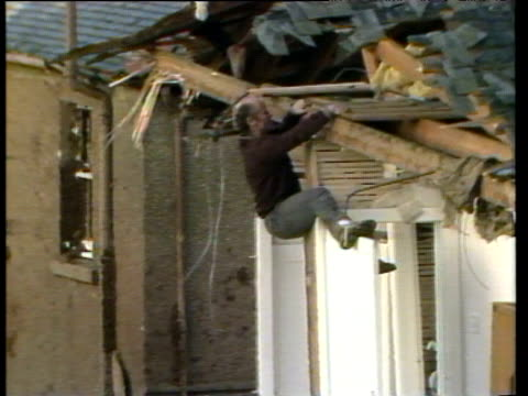 man climbs over wreckage of house lockerbie air disaster 22 dec 88 - lockerbie stock videos & royalty-free footage