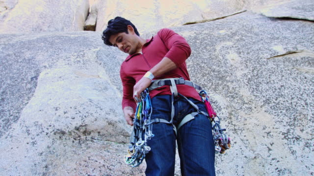 man clipping slcds onto climbing harness - angeles national forest stock videos and b-roll footage