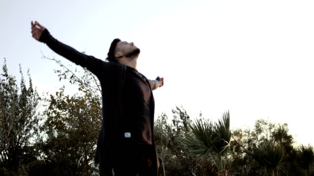 man closed eyes arm outstretched - spirituality stock videos & royalty-free footage