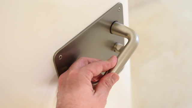 man closing / opening the door of a toilet. - bagno domestico video stock e b–roll
