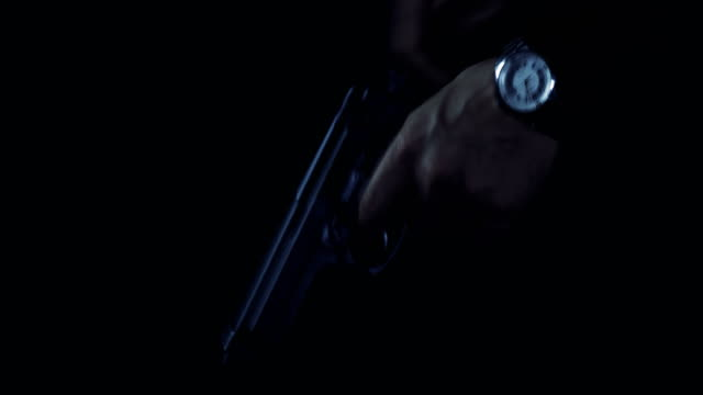 man cocking a gun preparing to fire - organized crime stock videos & royalty-free footage